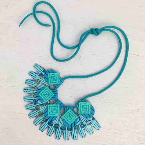 Light blue and turquoise art deco style necklace on a light background