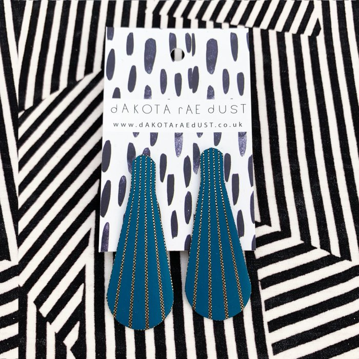 teal stud earrings on a stripey background