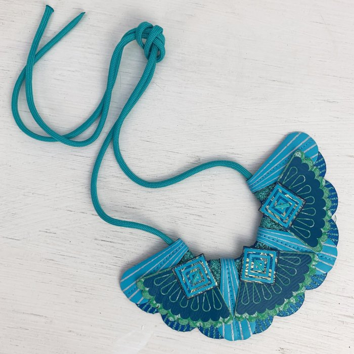 product shot of blue and teal bib necklace