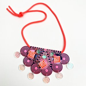 product shot of neon coral and pink statement charm necklace