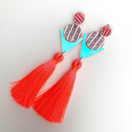 product shot of neon coral tassel earrings