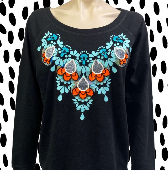 a black embellished sweatshirt customised with a blue and orange orate print