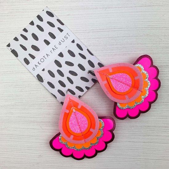 teardrop shaped, oversize earrings in pink, red and purple