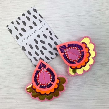 colourful statement earrings in pink, orange and gold
