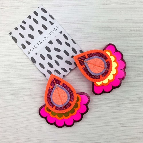 Colourful oversize earrings in fluoro pink orange and gold