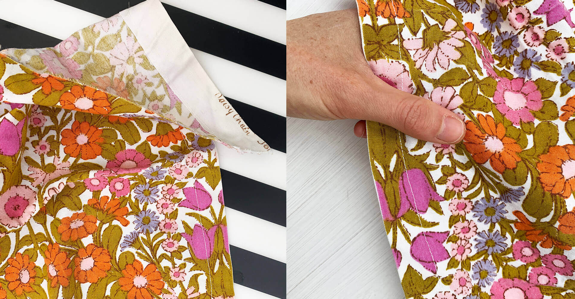 A close up of some retro floral print fabric, seen on the left hand side of the image against a black and white boldly striped background, and on the right hand side of the image being held by a white woman's hand to show the scale of the print.
